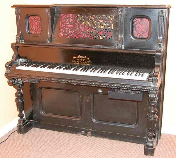 14: MATHUSHEK PIANO CASE WITH ELECTRIC PLAYER MECHANISM