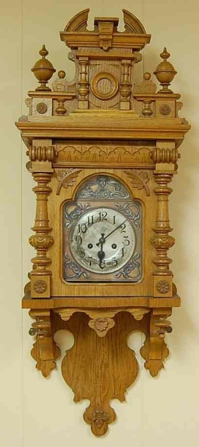 1003: VICTORIAN OAK WALL CLOCK