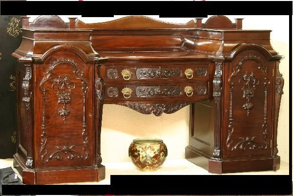 100: Carved English Mahogany Double Pedestal Sideboard
