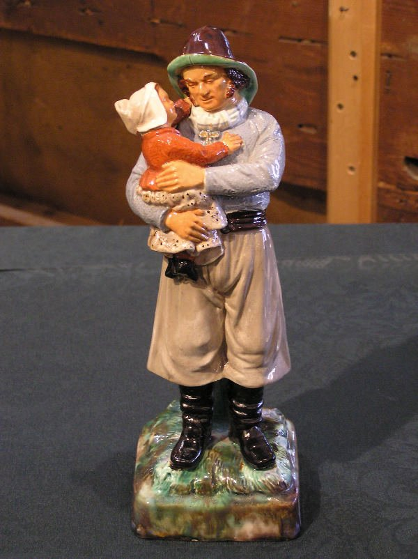 8: Figure of a Father and Child
