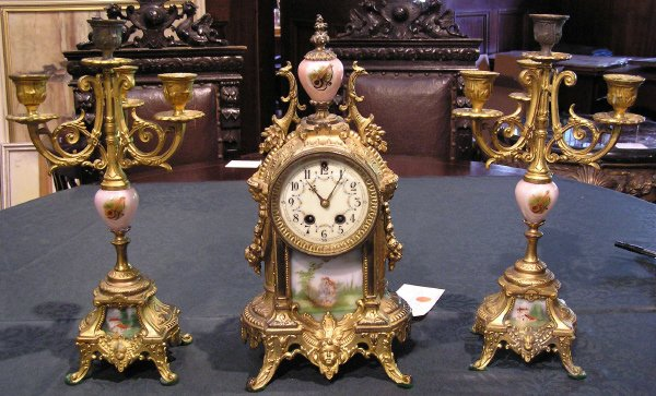 7: Gilbert Three Piece Porcelain and Bronze Clock Set