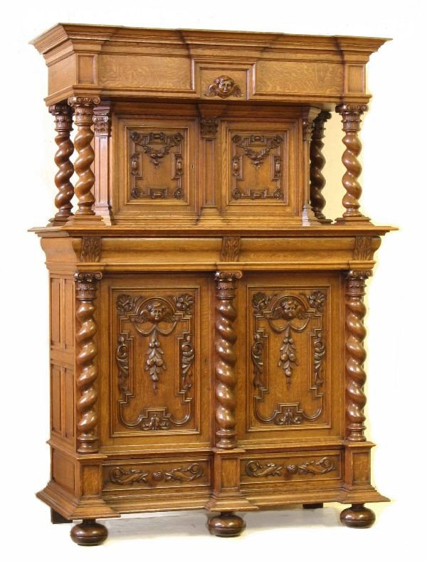 19: Twelve Piece Carved Oak Dining Suite