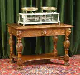 1071: Highly Carved Oak Table 562-1