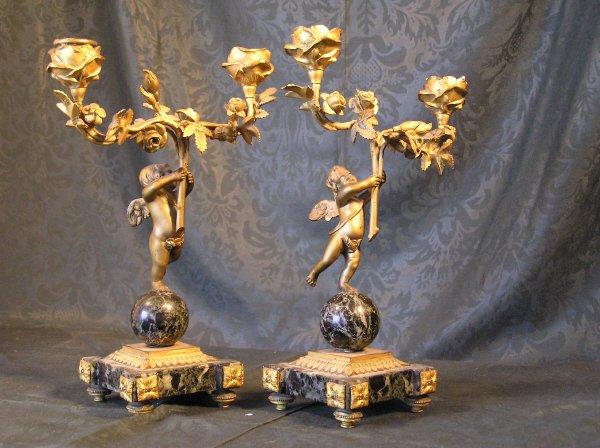 11: Pair of Bronze Cherub Candelabra