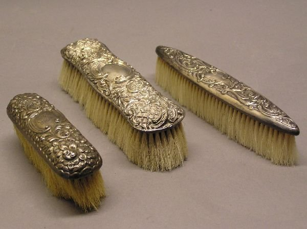17: Set of Three Dresser Brushes One Marked Sterling
