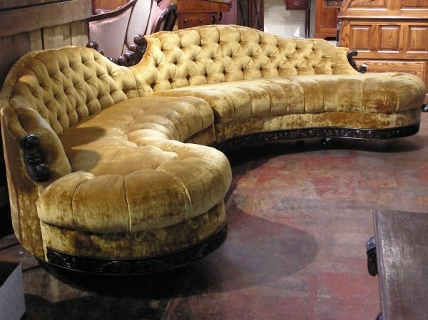 32: Unusual Two Section Curved Sofa