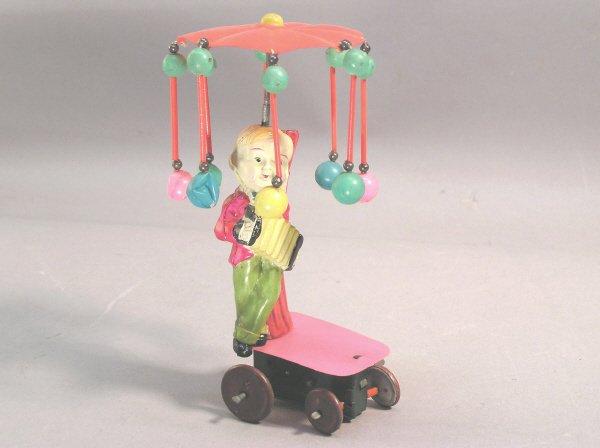 3: Wind Up Celluloid Boy Under Umbrella Toy