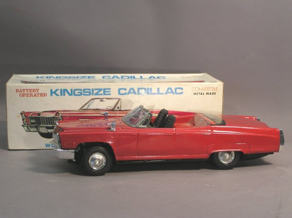 9: Battery Operated Metal Cadillac Toy Car