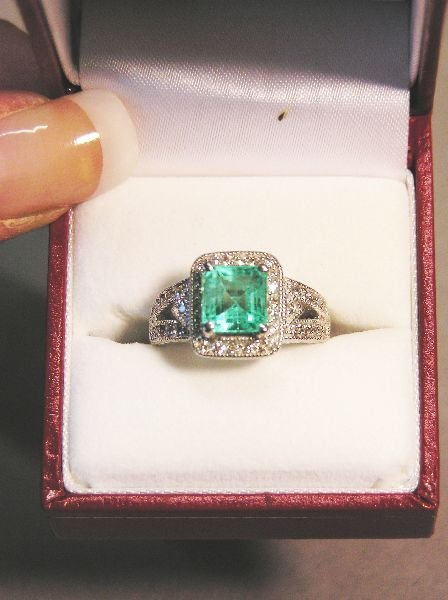 1021: Ladies Emerald and Diamond Ring