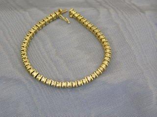 8: 14k Gold and Diamond Tennis Bracelet  J4