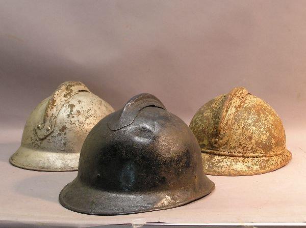 12: Group of Three Military Helmets
