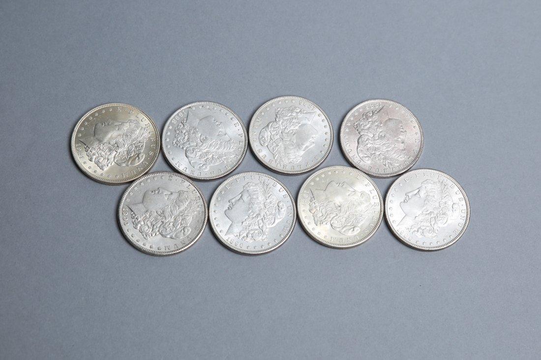 Lot of 8 Morgan Silver Dollars