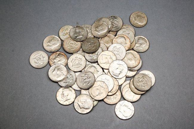 56 Loose Kennedy Half dollars 40% Silver 1965-1969