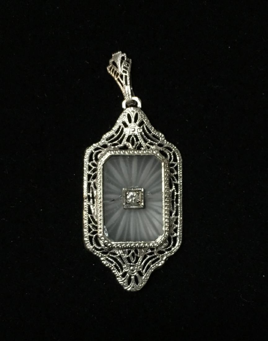 14 Kt White Gold Lady's Pendant 2.1 dwt w/.05 ct