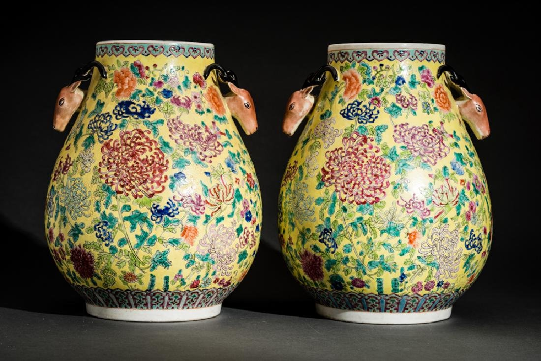PAIR OF VASES WITH STAG HEADS