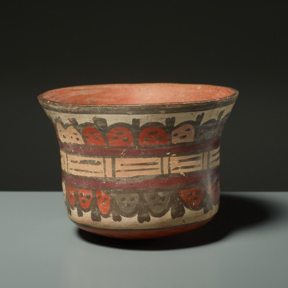 CUP WITH TROPHY HEADS