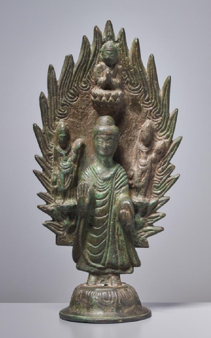 EARLY BRONZE OF A BUDDHA IN FRONT OF A FLAMING HALO