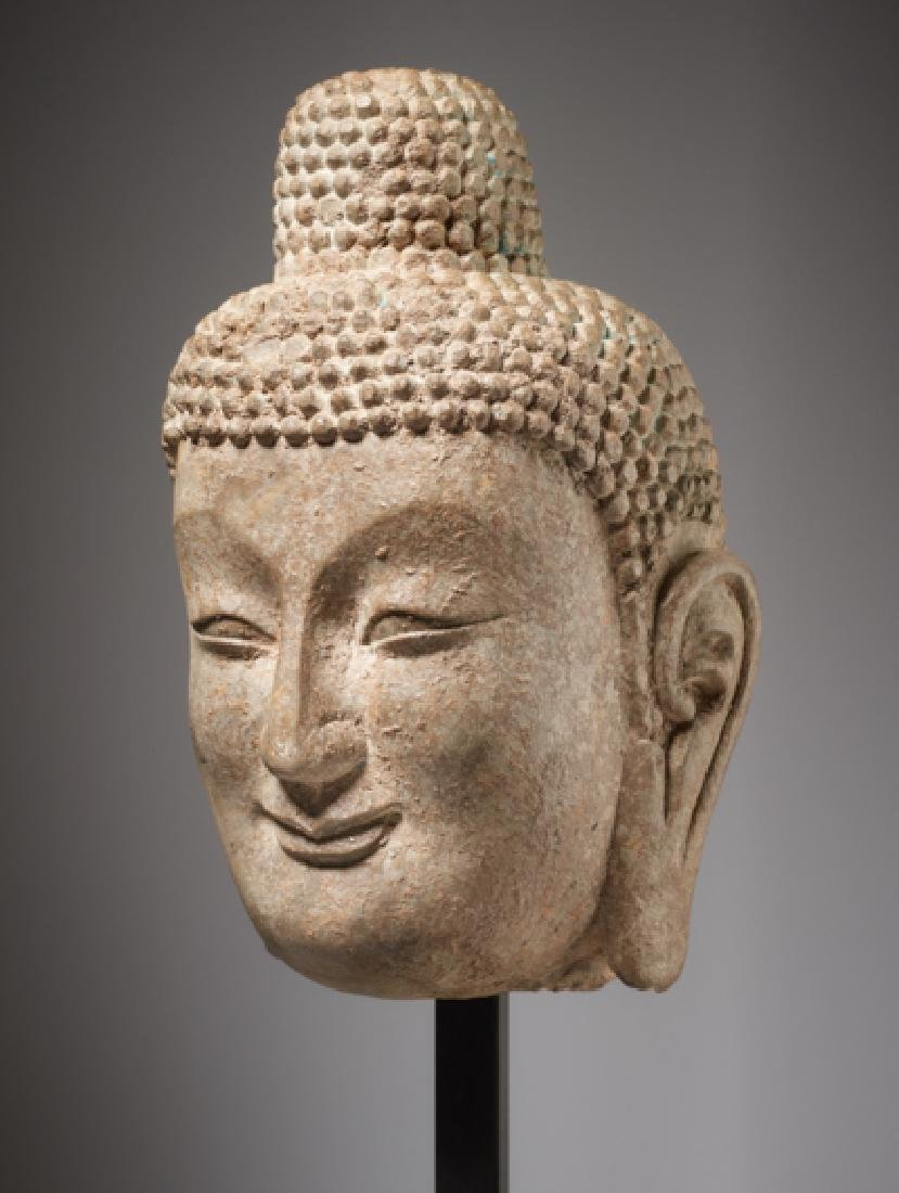 LARGE HEAD OF A SMILING BUDDHA