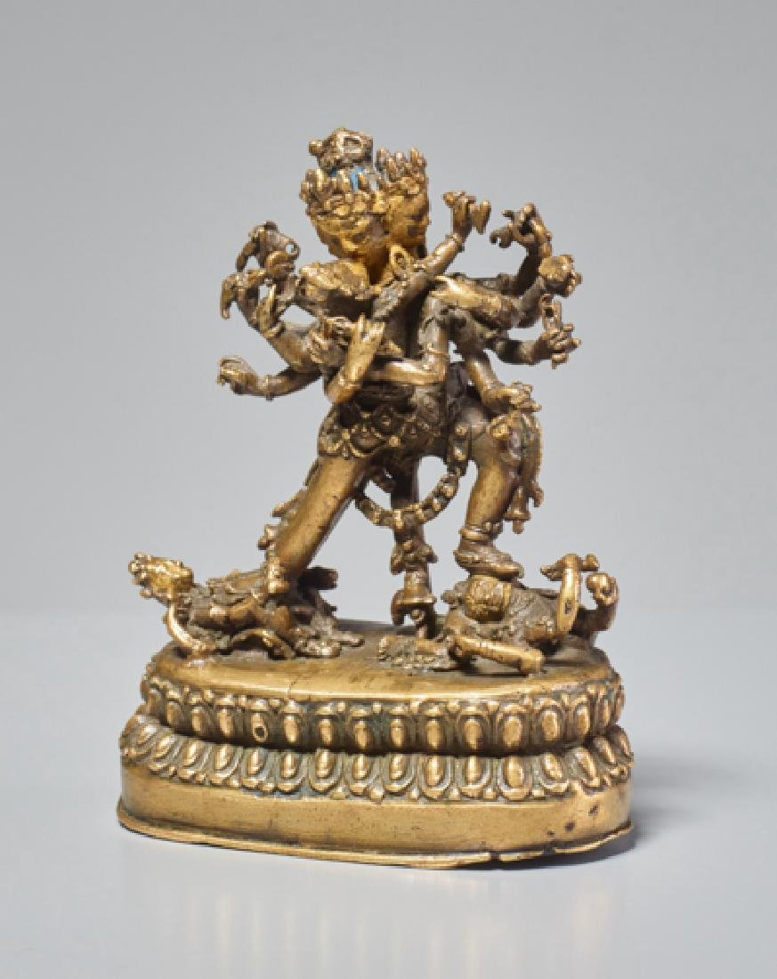 SMALL BRONZE FIGURE OF THE FOUR-HEADED CAKRASAMVARA