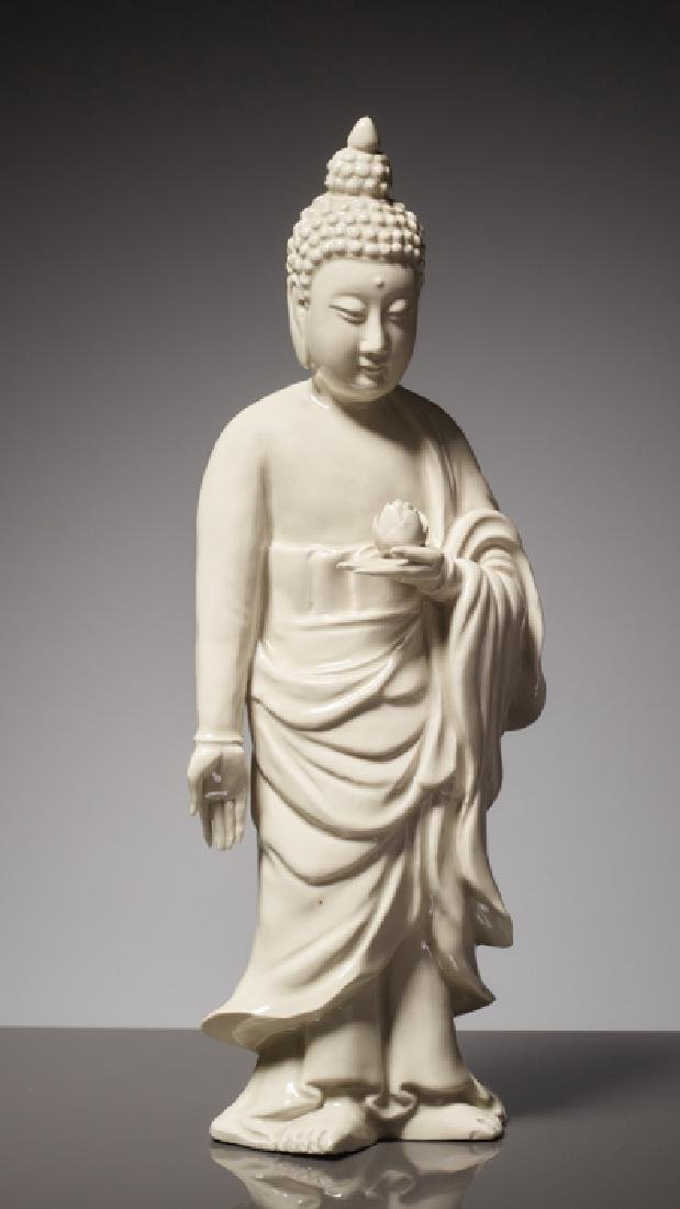 EARLY BLANC DE CHINE FIGURE OF A STANDING BUDDHA