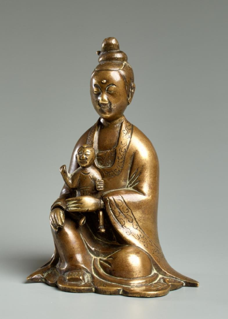 THE GODDESS GUANYIN WITH CHILD