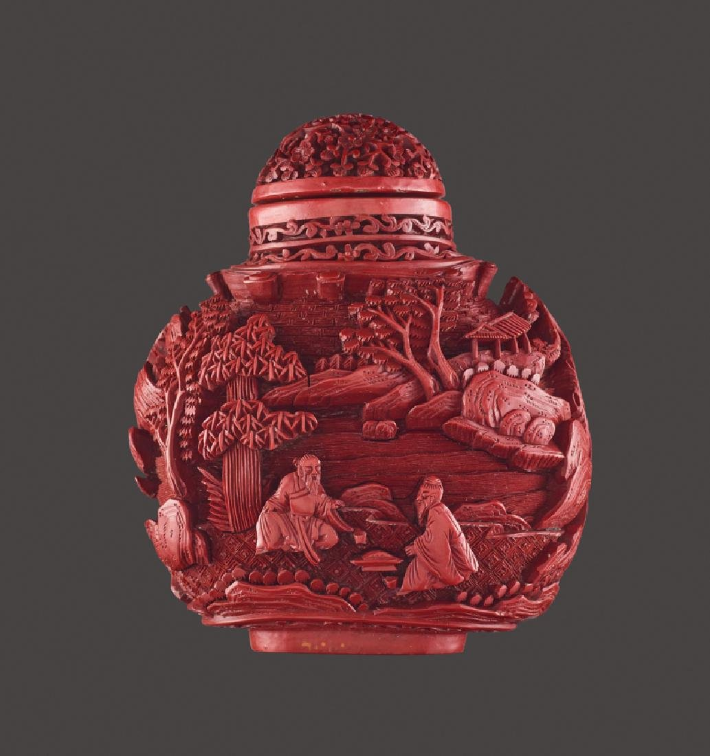 A LARGE SCENIC CARVED CINNABAR LACQUER SNUFF BOTTLE