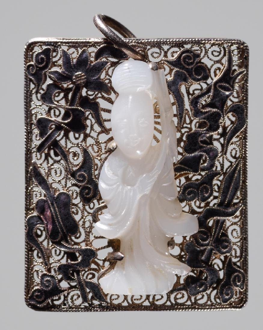 AN ENAMELED SILVER PENDANT WITH A WHITE JADE GUANYIN,