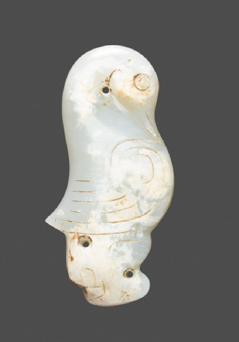 A RARE SCULPTURAL STANDING BIRD IN EXQUISITE WHITE JADE