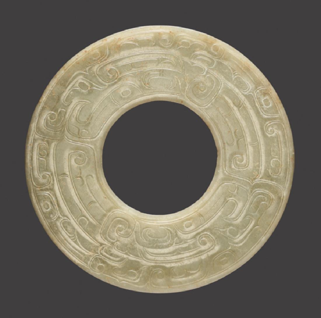A LARGE DISC WITH DOUBLE ONELEGGED DRAGON (KUI) DESIGN