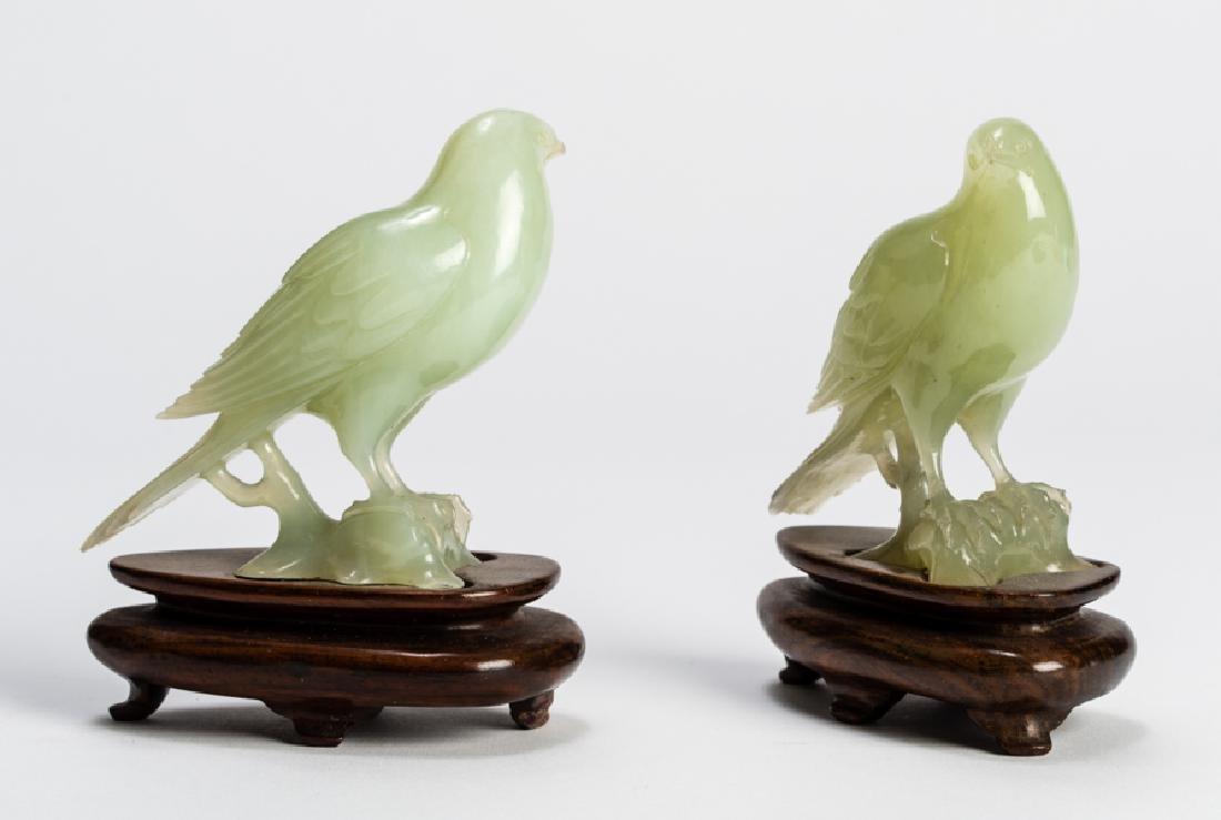 AN ATTRACTIVE PAIR OF JADEITE BIRDS ON STANDS