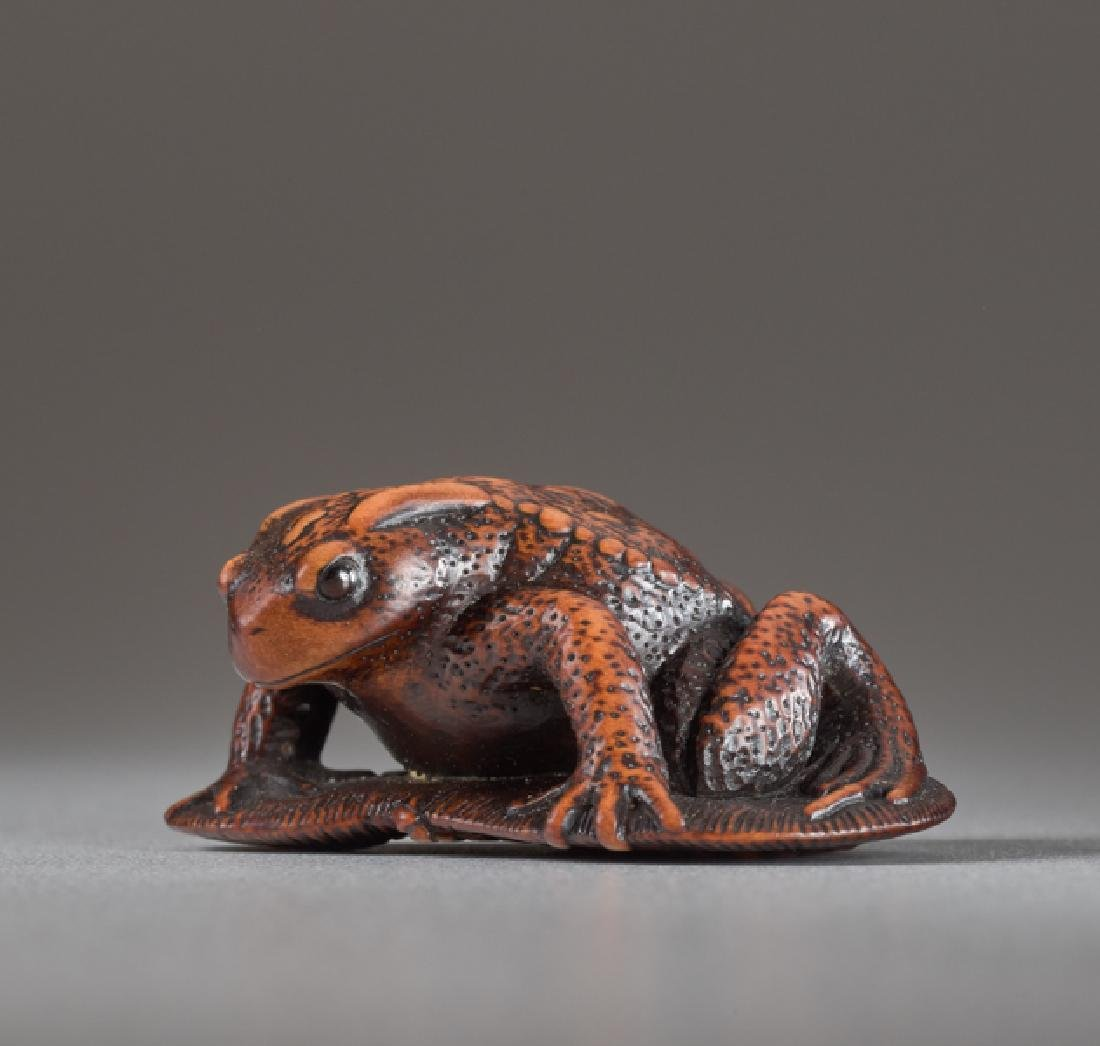 A WOOD NETSUKE BY TANRI OF A TOAD ON A SANDAL - 2