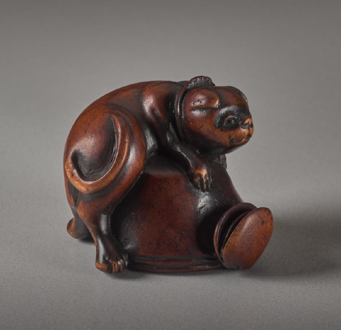 A WOOD NETSUKE OF A DOG AND OCTOPUS - 2