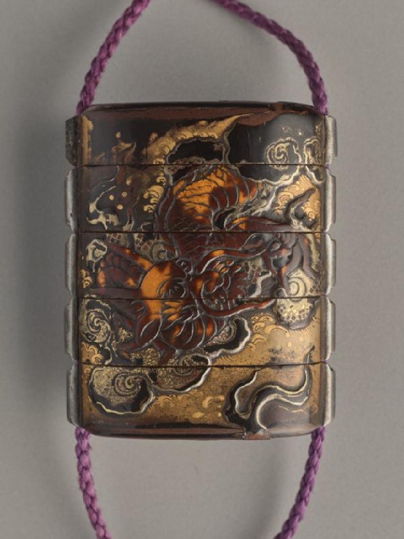 A THREE CASE LACQUER INRO OF A CELESTIAL DRAGON