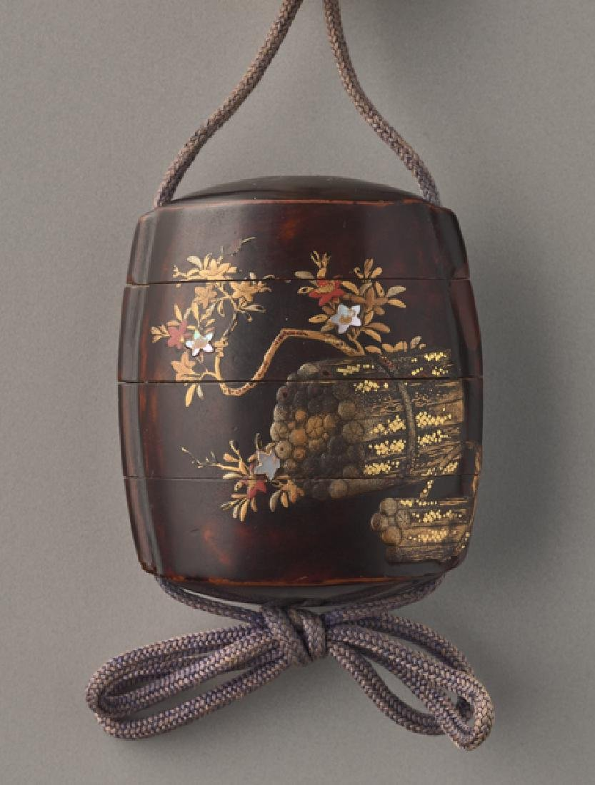 AN UNUSUAL LACQUER INRO OF BLOSSOMS AND SCROLL