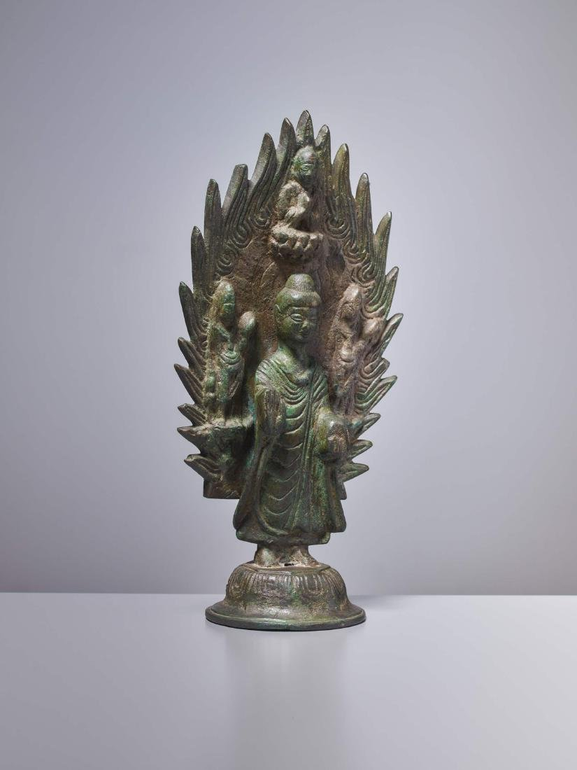 A BRONZE BUDDHA IN FRONT OF A FLAMING HALO, DATED 571 - 3