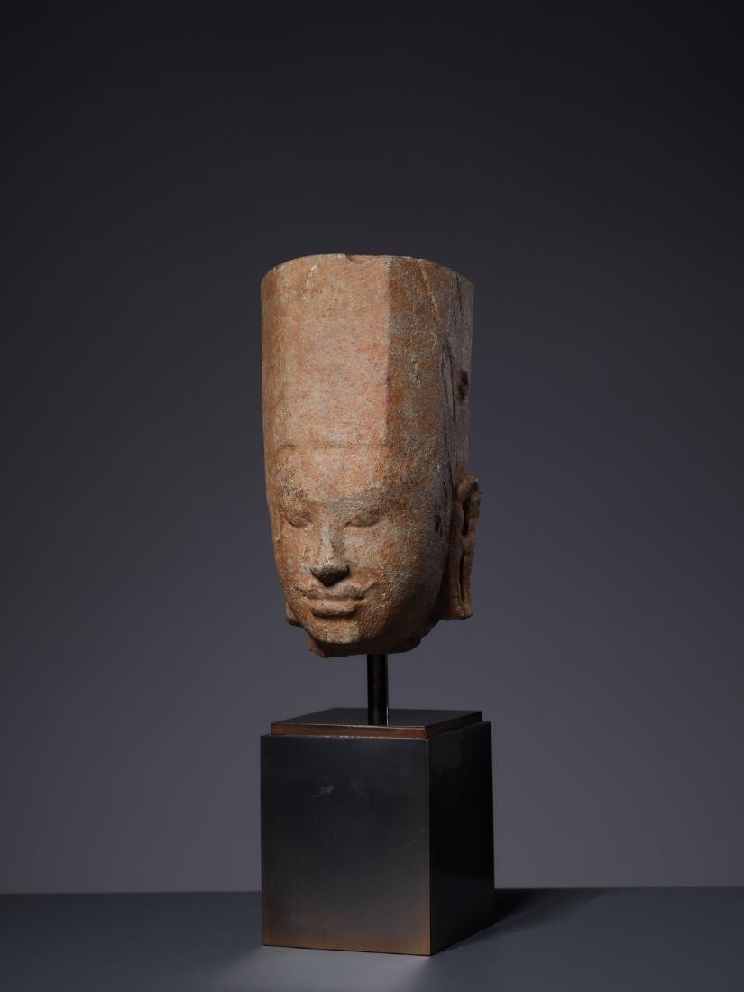 A SANDSTONE HEAD OF A DEITY, KHMER, PRE-ANGKOR PERIOD