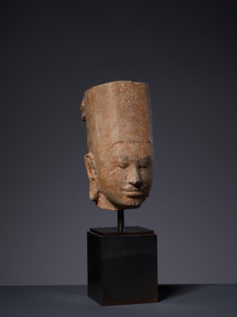 A SANDSTONE HEAD OF A DEITY, KHMER, PRE-ANGKOR PERIOD - 2