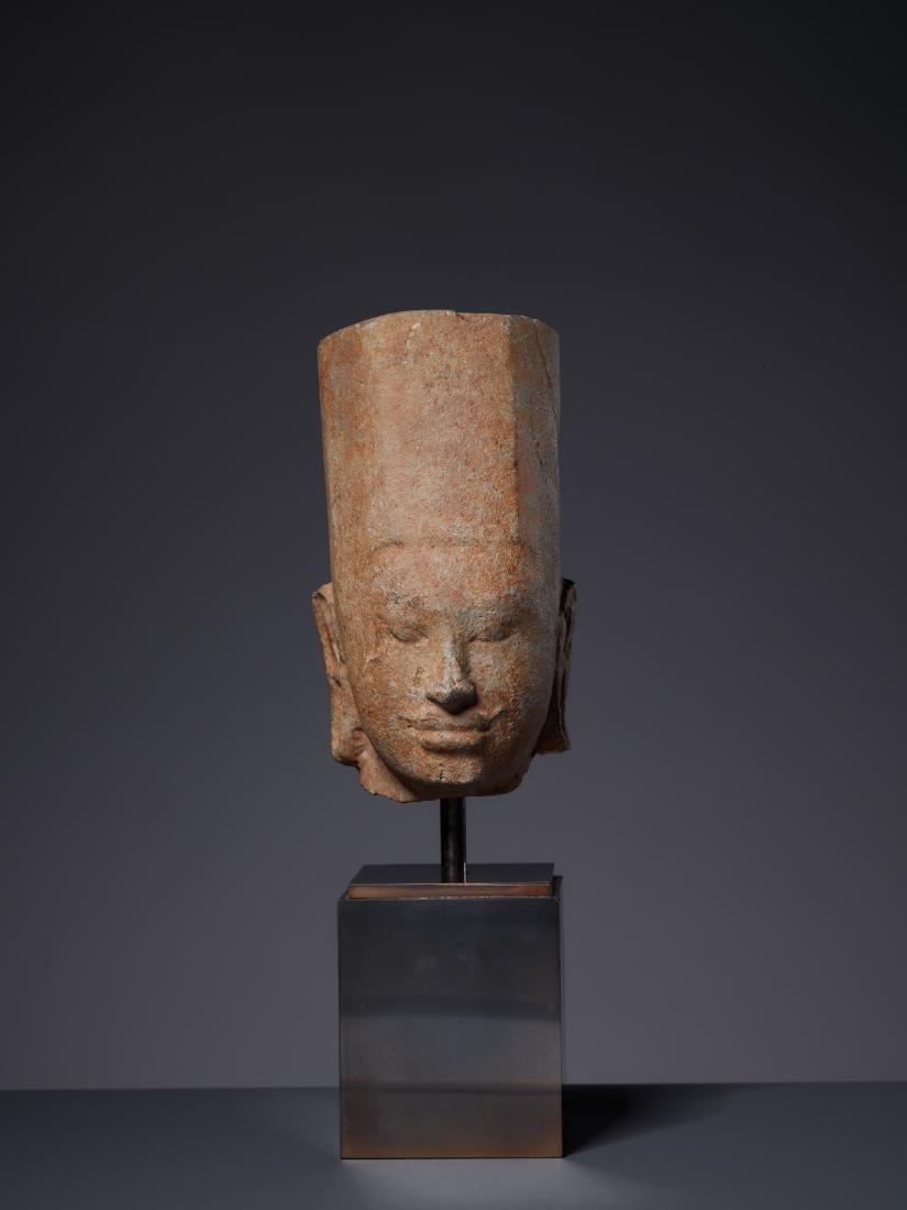 A SANDSTONE HEAD OF A DEITY, KHMER, PRE-ANGKOR PERIOD - 4