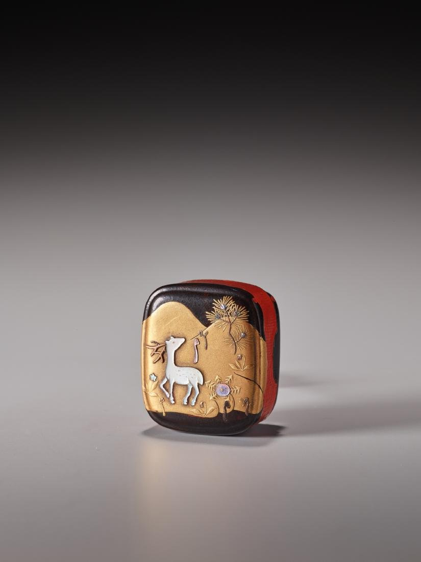 A LACQUERED AND INLAID HAKO NETSUKE WITH STAG