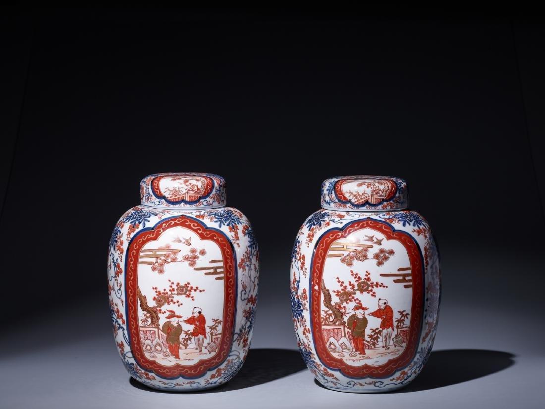 A PAIR OF IMARI PORCELAIN GINGER JARS WITH LIDS