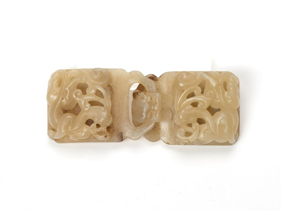 A CELADON JADE BELT BUCKLE WITH CHILONG AND LINGZHI