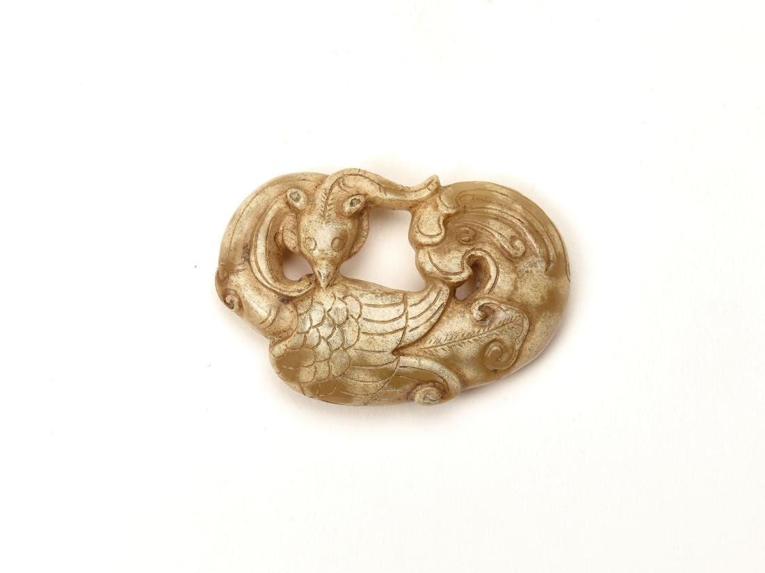 A WARRING STATES STYLE JADE PENDANT WITH A PHOENIX