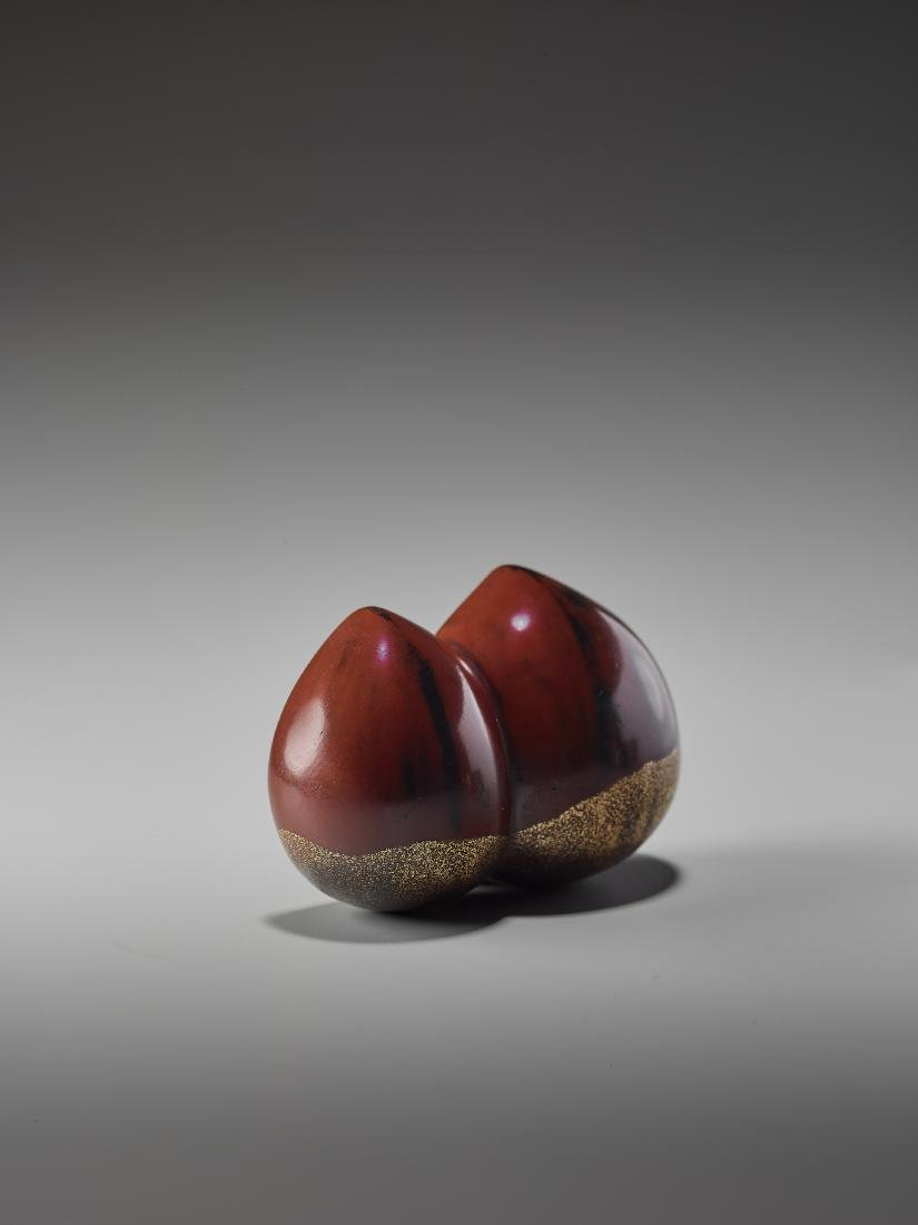 A LACQUERED WOOD NETSUKE OF A PAIR OF CHESTNUTS