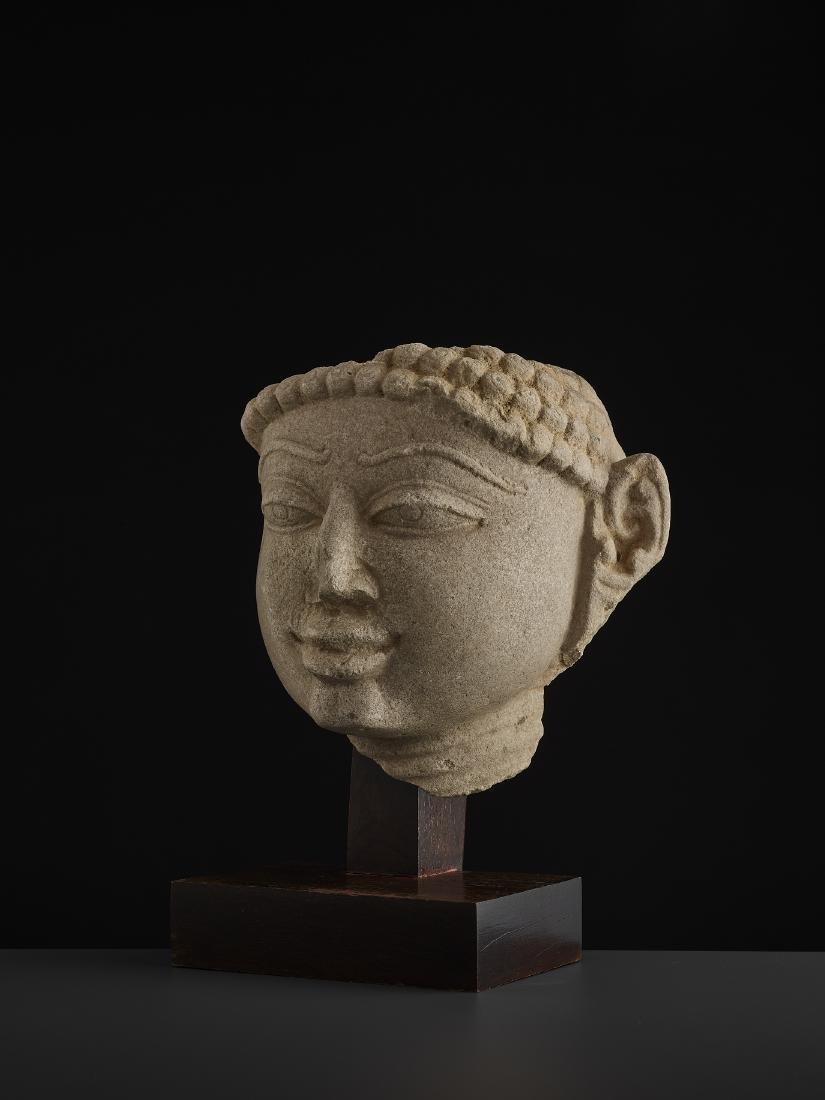 A SANDSTONE HEAD OF A TIRTHANKARA - 3