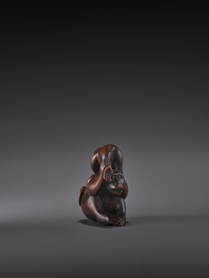 A WOOD NETSUKE OF MONKEYS AND PEACH SIGNED MASATSUGU