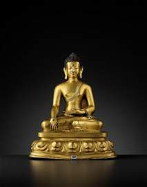 A GILT COPPER ALLOY BUDDHA, DENSATIL 14TH-15TH CT