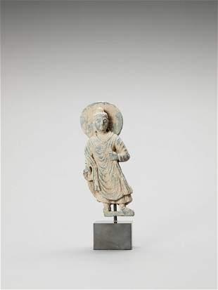 A GANDHARAN SCHIST FIGURE OF BUDDHA, MID-3rd CENTURY AD