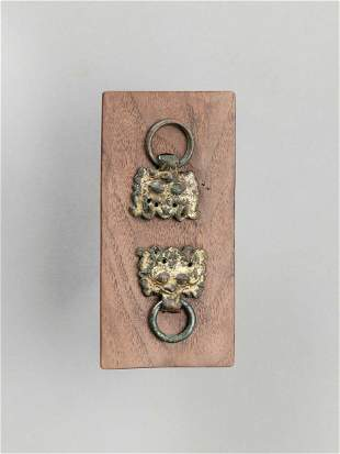 TWO ARCHAISTIC GILT BRONZE TAOTIE-MASK RING-HANDLES