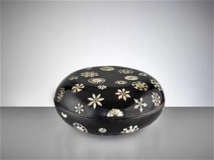 A MOTHER-OF-PEARL-INLAID BLACK LACQUER BOX AND COVER
