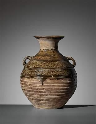 A BROWN-GLAZED POTTERY JAR, HU, HAN DYNASTY